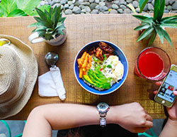 person sitting in front of a healthy meal