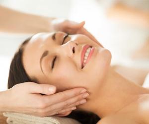 a woman receiving a shoulder massage