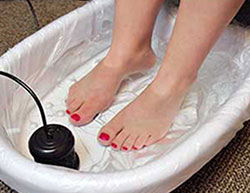 a person bathing their feet