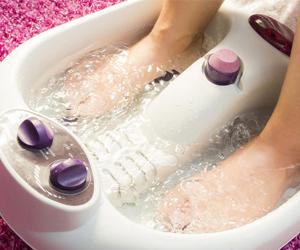 a person receiving a foot bath
